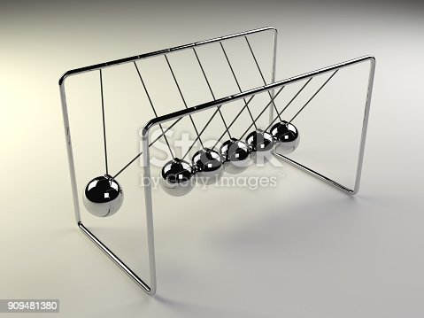 921145928 istock photo Newton's cradle in motion, silver cradle on white surface 909481380