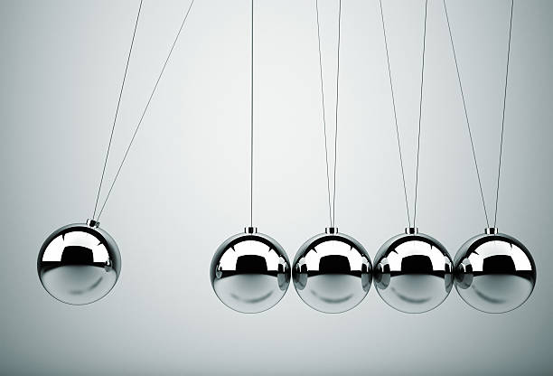 newton's cradle - perpetual motion stock photos and pictures