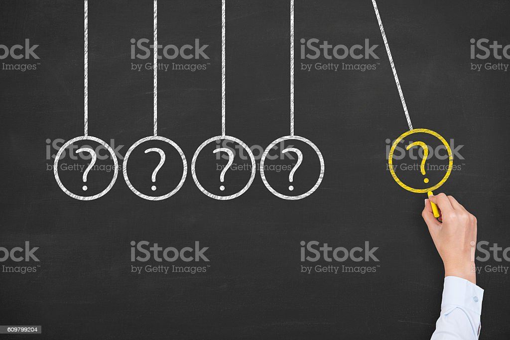 Newtons Cradle Question Mark on Blackboard Background stock photo