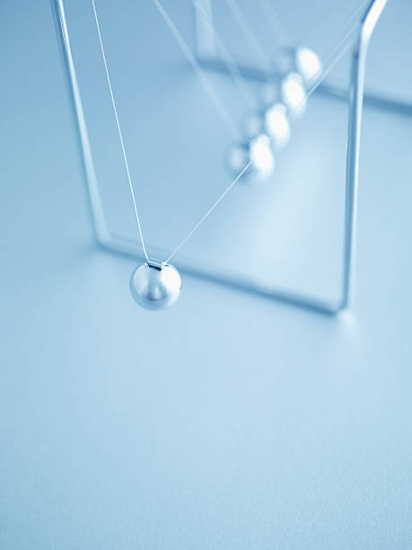 newtonã�s cradle swinging - perpetual motion stock photos and pictures