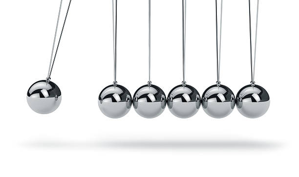 newtons cradle with metal balls hanging in a line - pendulum stock photos and pictures
