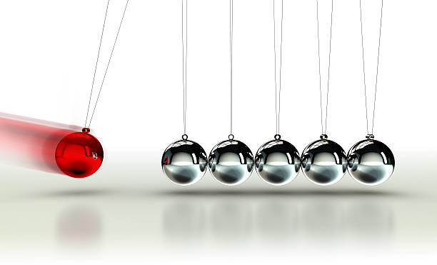 newton's cradle with red ball - pendulum stock photos and pictures