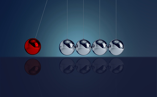 3D Rendered Newton's pendulum with colorful background - Leadership/individuality concepts. Red chrome sphere hitting to regular spheres.