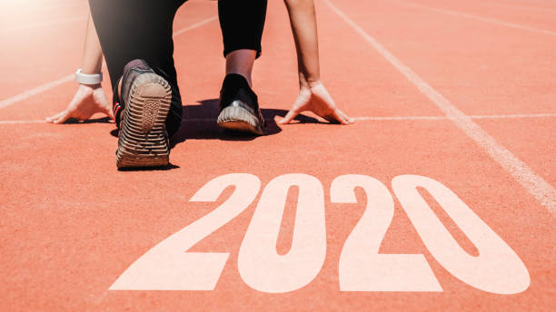 2020 Newyear , Athlete Woman starting on line for start running with number 2020 Start to new year. 2020 Newyear , Athlete Woman starting on line for start running with number 2020 Start to new year. starting line stock pictures, royalty-free photos & images