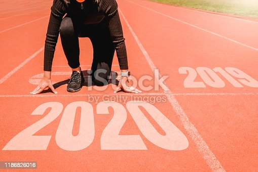 istock 2020 Newyear , Athlete Woman starting on line for start running with number 2020 Start to new year. 1186826016