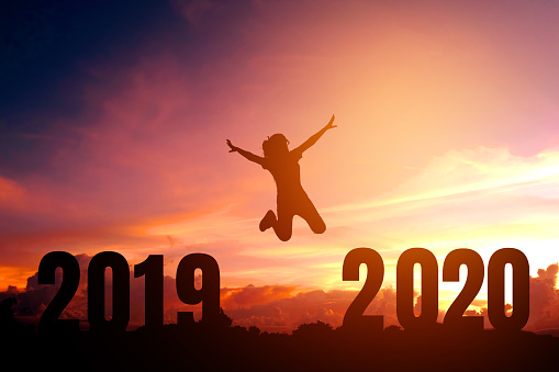 istock 2020 Newyear Silhouette young woman jumping to Happy new year concept. 1134372730