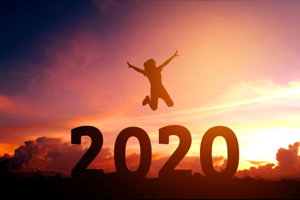 2020 Newyear Silhouette young woman jumping to Happy new year concept. stock photo