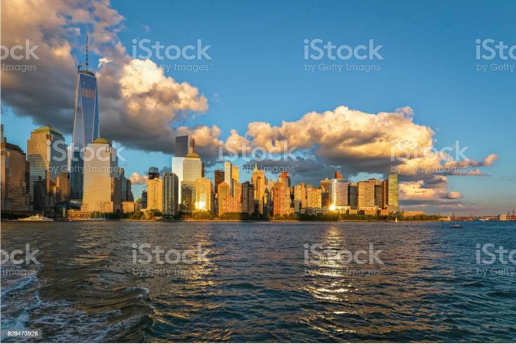 New-York midtown view over Hudson River at sunset with big clouds stock photo