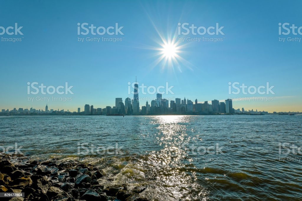 New-York midtown view over Hudson River with blue sky and sun stock photo