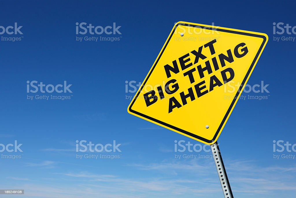 Next Big Thing on yellow road sign stock photo