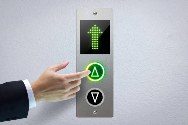 Next Level Up Hand of a man pressing the elevator button for next levels up in concept of more advance to a success. push button stock pictures, royalty-free photos & images