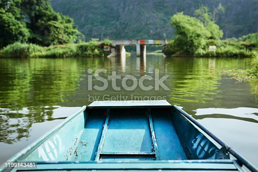 Shot of a boat floating down a river in Vietnam