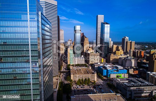 542727462 istock photo Next to Glass Windows Extending out into the Huge Houston , Texas Downtown Skyline Cityscape 981004050