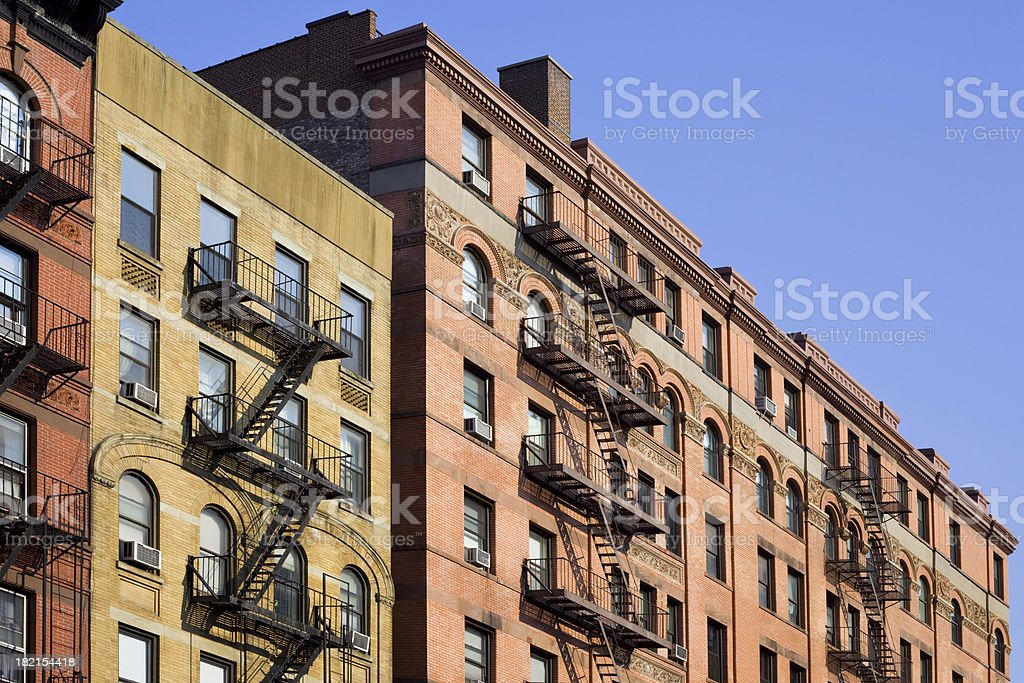 Ney York City Apartments with Fire Escape Ladder royalty-free stock photo