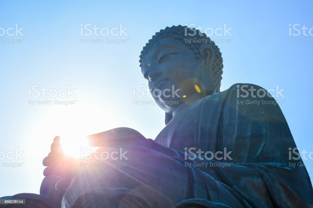Ngong Ping buddha statue has a light on his hand. stock photo