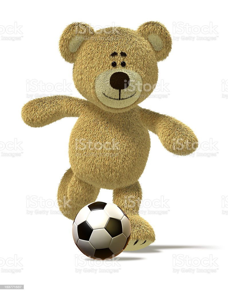Nhi Bear kicks off a soccer ball royalty-free stock photo