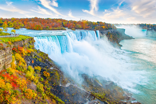 Niagara Falls including American Falls in foreground and Horseshoe Falls in background, with autumn leaf colors