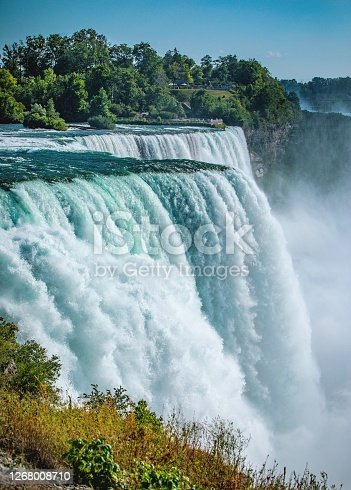 Vertical orientation of Niagara Falls in the afternoon sunlight