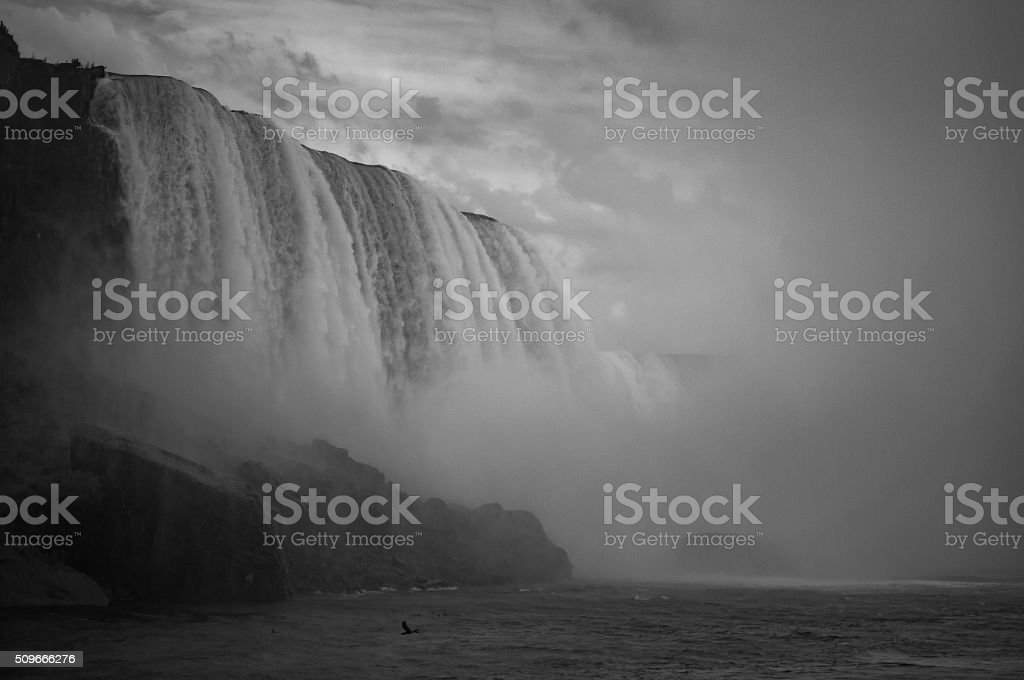 Niagara Falls Niagara Falls in black-and-white seen from one of the Maid of the Mist boats going towards the falls. Black And White Stock Photo