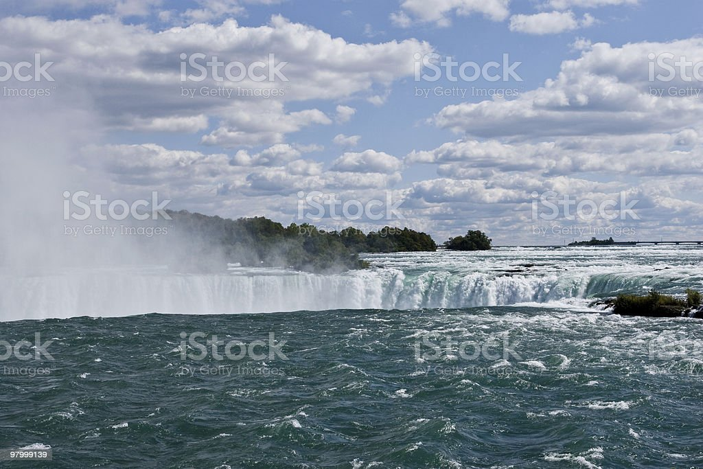 Niagara Falls water blue sky white clouds spray mist NY royalty-free stock photo