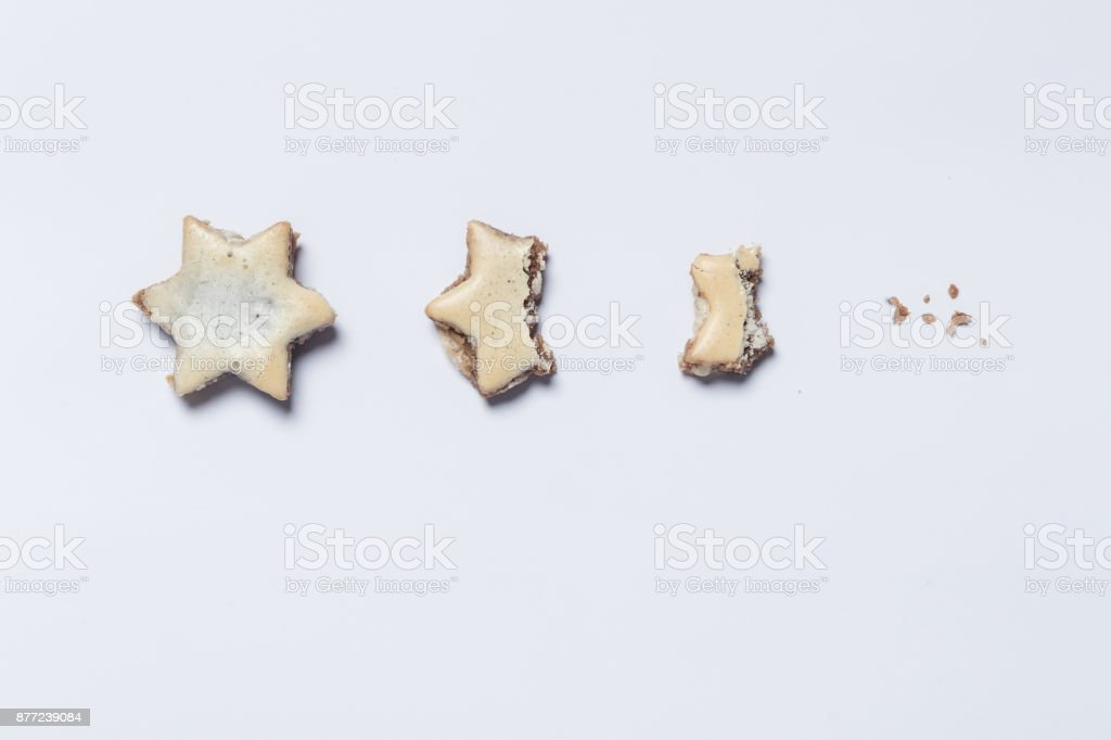 nibbled off cinnamon stars on white background as symbol of the advent season stock photo