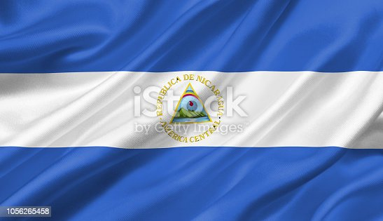 istock Nicaragua flag waving with the wind, 3D illustration. 1056265458