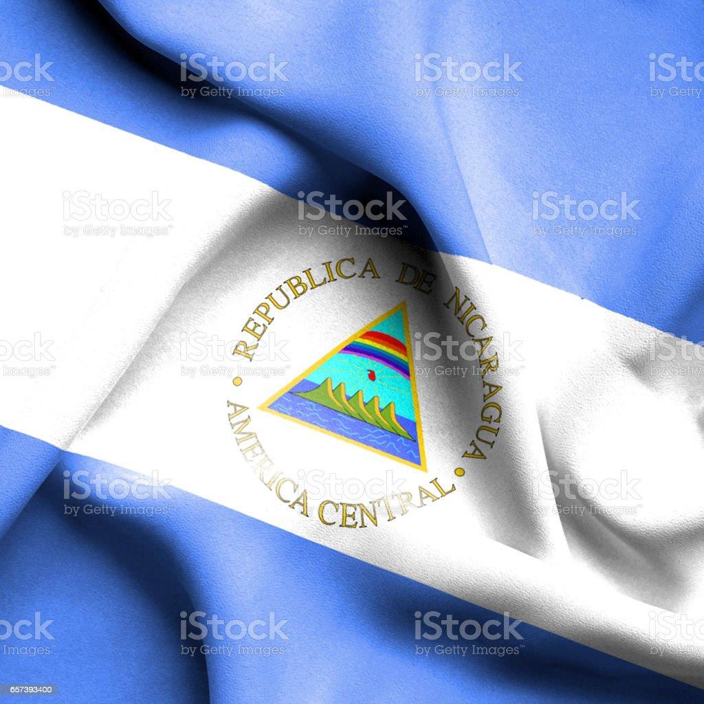 Bandera de Nicaragua Saludar con la mano - foto de stock
