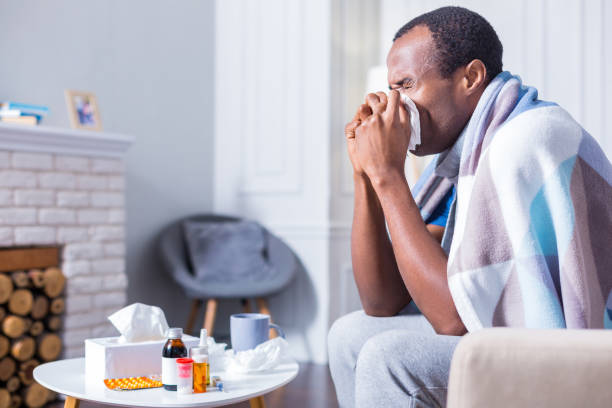 nice adult man sneezing - illness stock pictures, royalty-free photos & images
