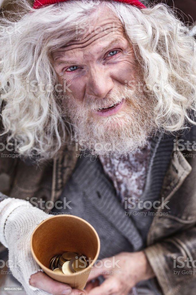 Nice aged man holding coins zbiór zdjęć royalty-free