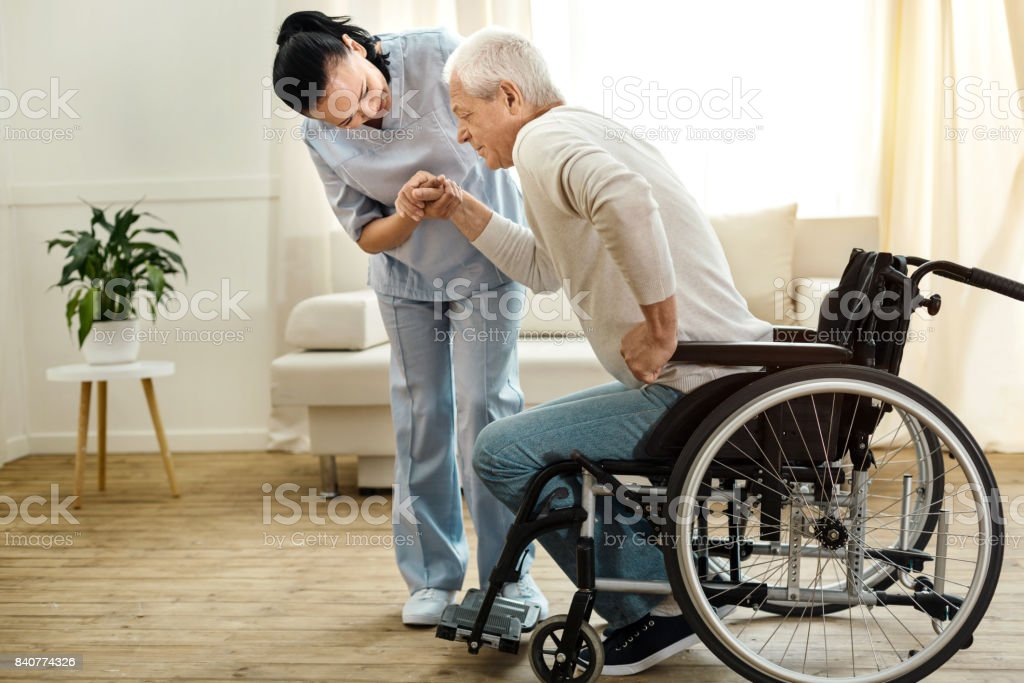 Nice aged man trying to get up stock photo