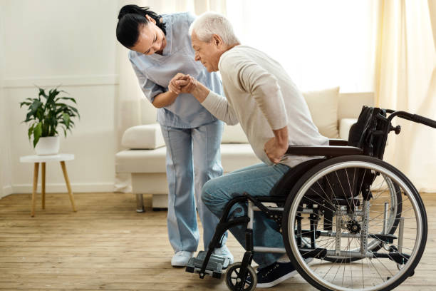 nice aged man trying to get up - wheelchair stock photos and pictures