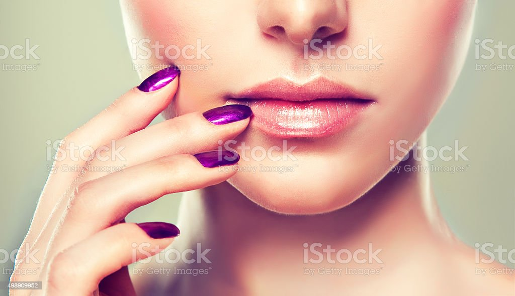 Nice and tender lips of young girl. stock photo