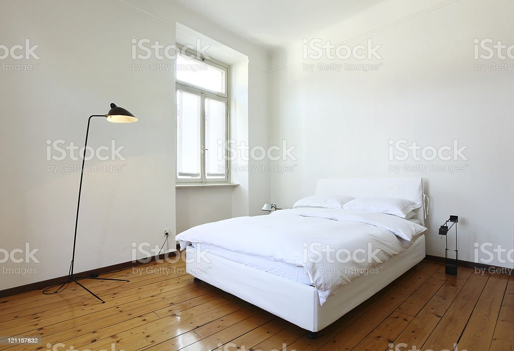 nice apartment refitted, bedroom with a double bed and lamps royalty-free stock photo