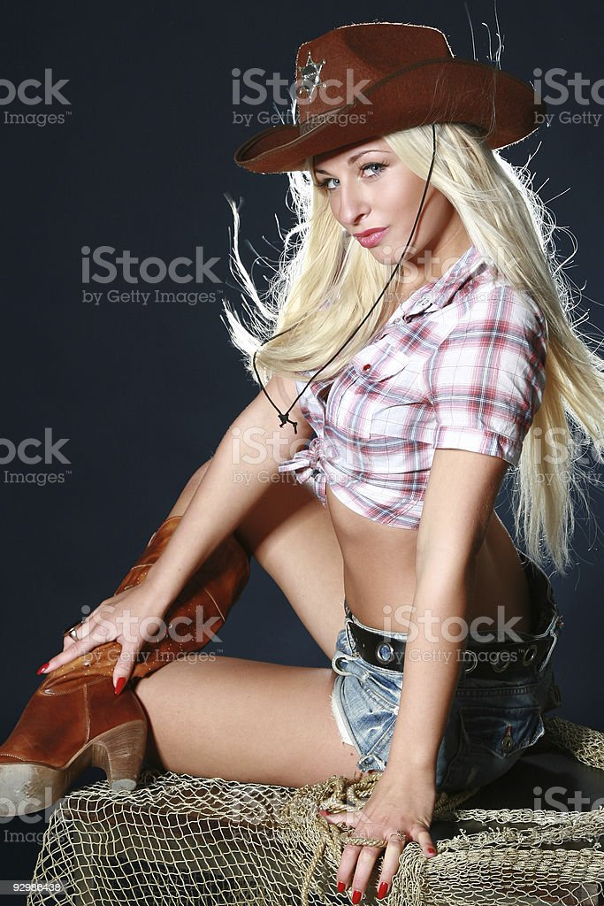 Nice babe in a cowboy's hat stock photo