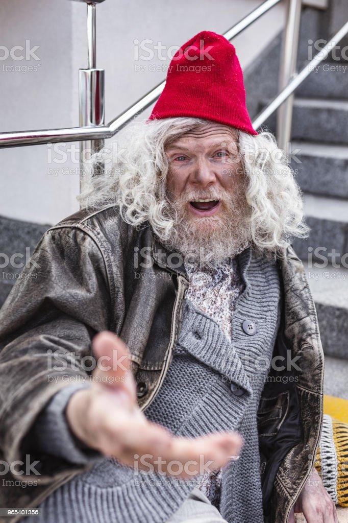 Nice bearded man asking for money zbiór zdjęć royalty-free