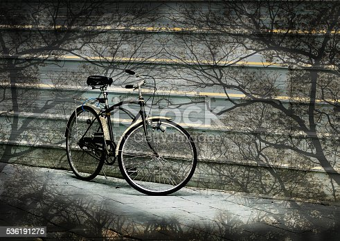 istock Nice bicycle with tree overlay, Abstract background 536191275