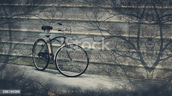 istock Nice bicycle with tree overlay, Abstract background 536194095