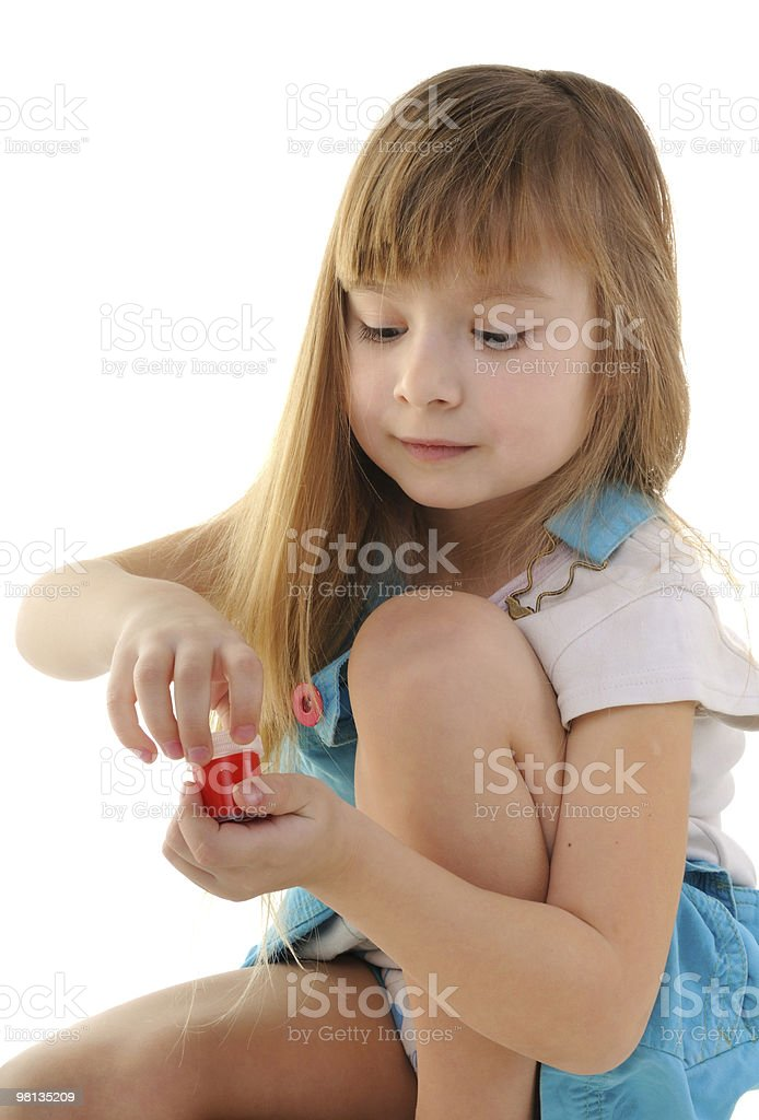 Nice blonde girl is painting royalty-free stock photo