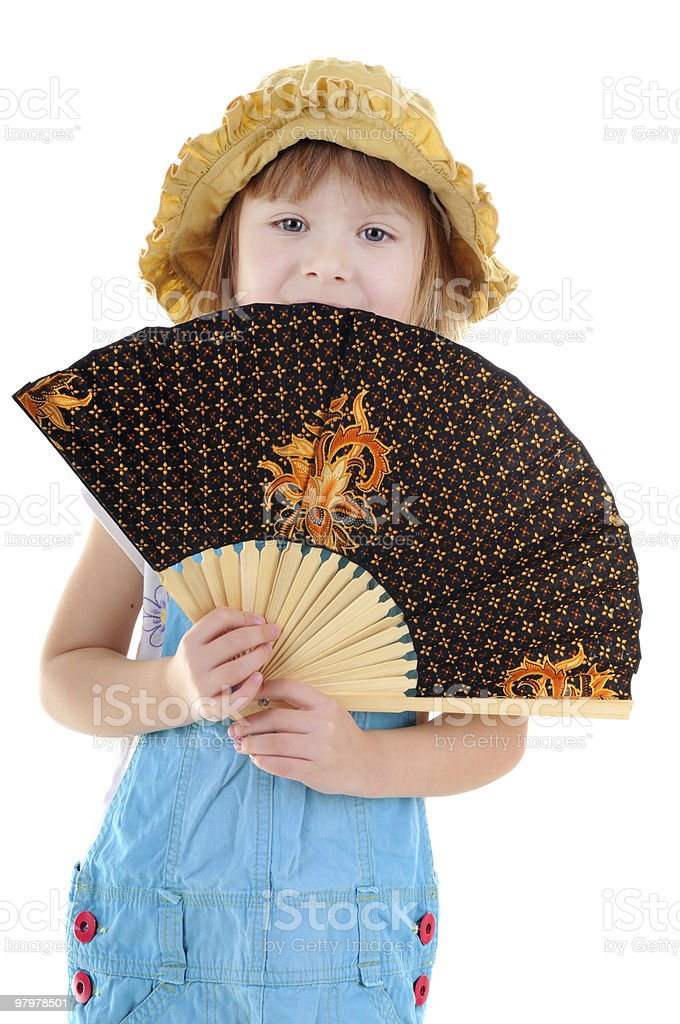 Nice blonde girl with a fan royalty-free stock photo