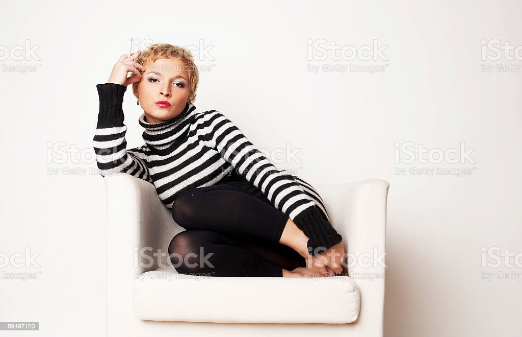 Nice blondgirl on the chair royalty free stockfoto