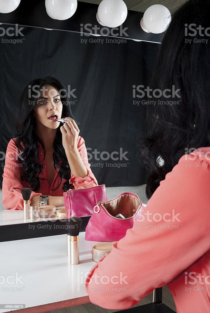 Nice brunette colors lip near the mirror royalty-free stock photo