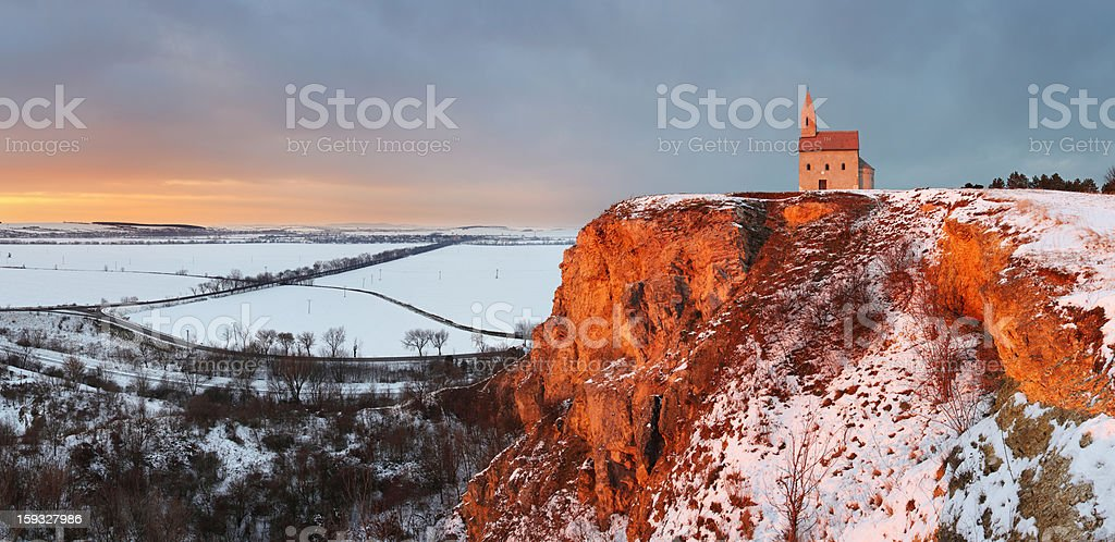 Nice Catholic Chapel in eastern Europe at winter landscape royalty-free stock photo