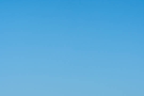 Nice cloudless empty light blue sky background stock photo