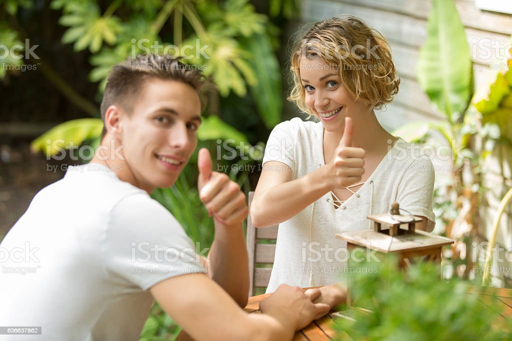 nice couple thumbs up - foto de acervo