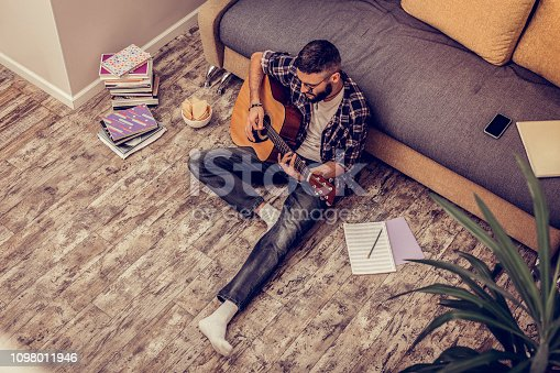 istock Nice creative handsome man composing a song 1098011946