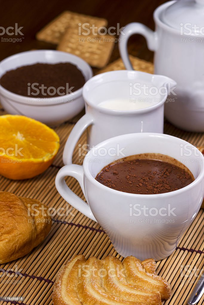 Nice cup of coffee with cocoa and croissant royalty-free stock photo