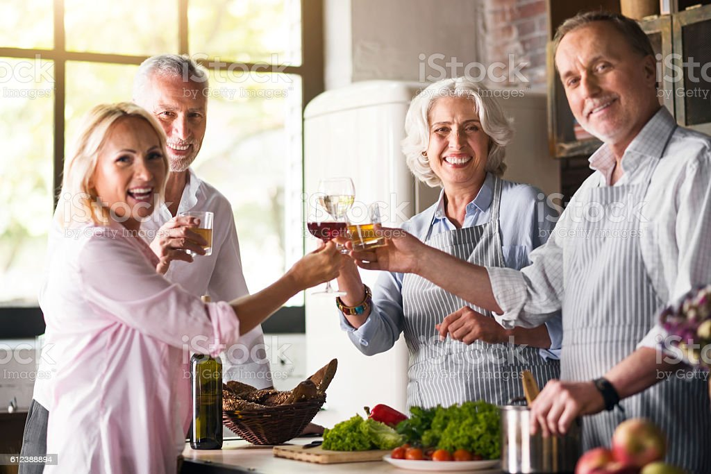 Nice family celebrating together in the kitchen stock photo