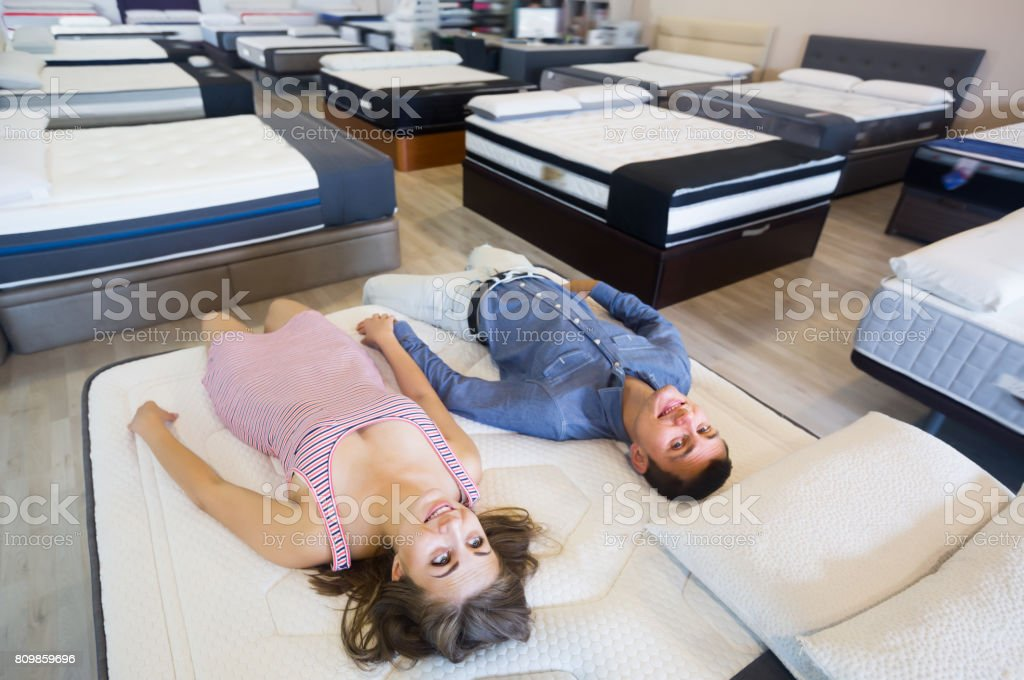 Nice family choosing mattresses stock photo