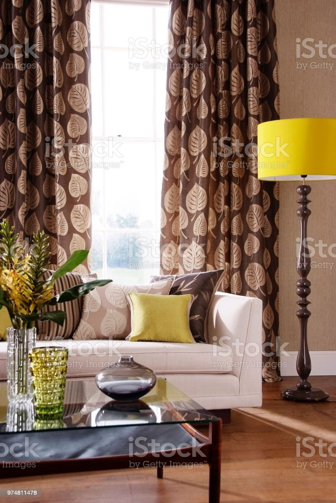 Nice furniture in living room, sofa with lamp and flower vase on...