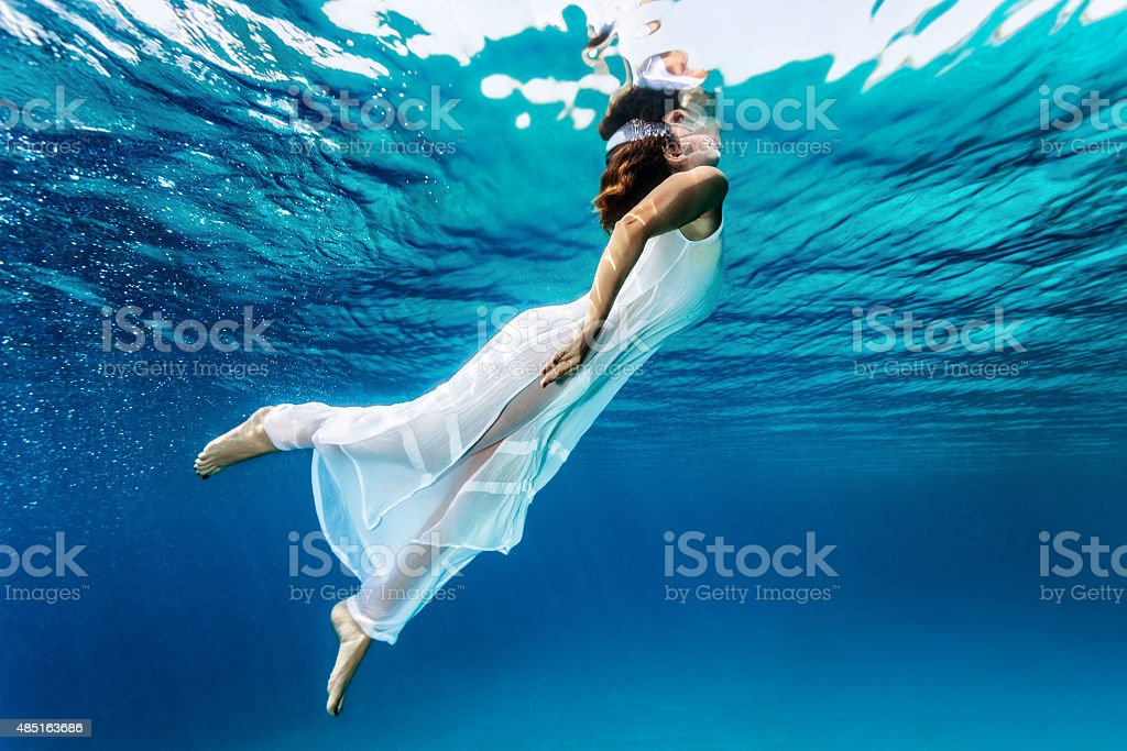 Nice girl emerges from the sea stock photo